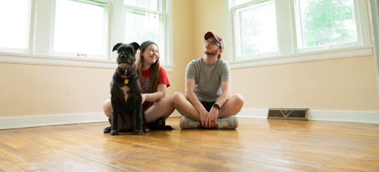 couple sitting in new house after having help from movers Lorton VA
