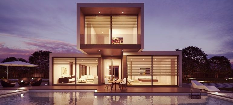 The exterior of a modern house with a pool.