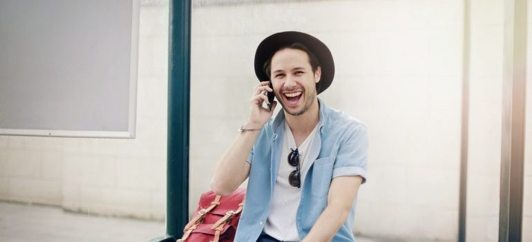 A smiling man talking on the phone with interstate movers Northern Virginia.