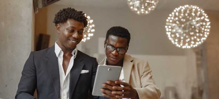 Two businessmen looking at tablet