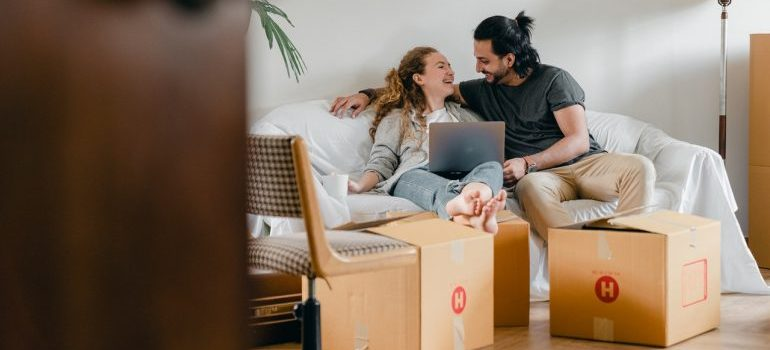 couple looking online for moving services Northern VA has to offer