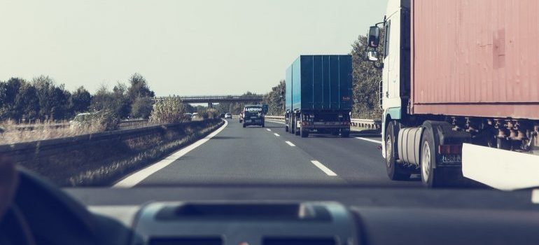 Moving trucks on the road.